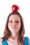 Young woman with an apple Stock Photo