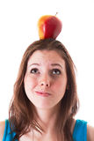 Young woman with an apple Royalty Free Stock Photo