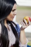 Young woman with an apple Royalty Free Stock Images