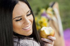 Young woman with an apple Stock Photos