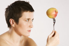 Young Woman and an Apple Royalty Free Stock Photos