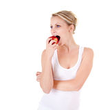 Young woman and apple. Young woman on white background Royalty Free Stock Photo