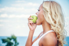 Young woman with an apple Royalty Free Stock Image