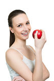 Young woman with apple and brackets on teeth Stock Photos