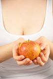 A young woman with an apple Royalty Free Stock Image