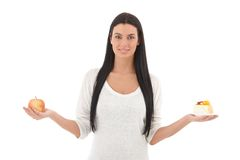 Young woman with apple and cake smiling Royalty Free Stock Photo