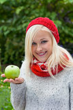 Woman with apple. vitamins in autumn. A young woman with an apple. fruits and vegetables are the right vitamins for a cool fall or winter Royalty Free Stock Image
