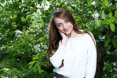 Young woman in the apple garden Stock Photos