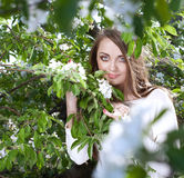 Young woman in the apple garden Royalty Free Stock Images