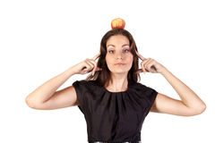 Young woman with apple on her head Royalty Free Stock Images