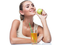 Young woman with apple juice stock photography