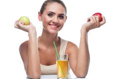 Young woman with apple juice Royalty Free Stock Photos