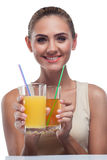 Young woman with apple juice stock images