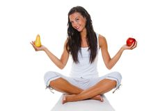 Young woman with apple and pear. A young woman holding an apple and a pear in his hand. Fit through healthy eating Royalty Free Stock Photo