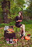Young woman with apples in the hands in autumn park. Smiling young woman with apples in the hands in autumn park with vegetables on autumn leaves stock photography
