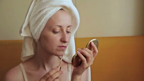 Young woman applies concealer foundation cream make up stock footage