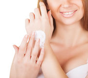 Cream on the women hand Stock Images