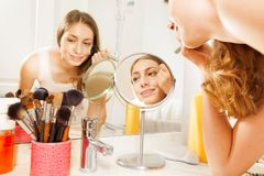 Free Young Woman Apply Makeup, Seen In Bathroom Mirror Stock Photo - 103815060