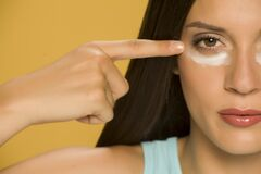 Free Young Woman Applying A Creme On Her  Low Eyelids Stock Image - 169262311