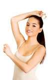 Young woman applying anti perspirant. Stock Photography