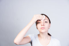 Young Woman Applying Astringent on Forehead Royalty Free Stock Image