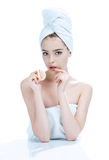 Young woman applying blush on her face with powder puff Royalty Free Stock Photography