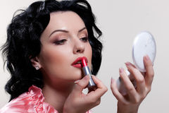 Young Woman Applying Cosmetics Royalty Free Stock Images