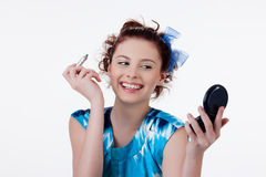 Young Woman Applying Cosmetics stock photos