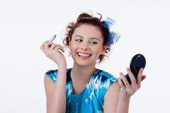 Young Woman Applying Cosmetics Stock Photos