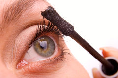Young woman applying cosmetics on eyelashes macro Royalty Free Stock Photography