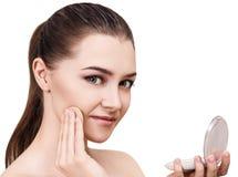 Young woman applying cosmetics powder. Royalty Free Stock Image