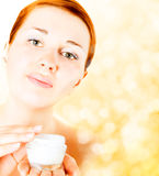 Young  woman applying cream Royalty Free Stock Images