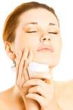 Young woman applying cream Stock Image