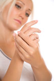 Young Woman Applying Cream To Hands Royalty Free Stock Image