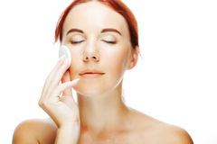 Young woman applying a creme on her face Royalty Free Stock Photo
