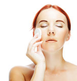 Young woman applying a creme on her face Royalty Free Stock Images