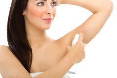 Young woman applying deodorant Stock Image