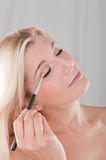 Young woman applying eye make-up Royalty Free Stock Photo
