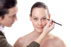 Young woman applying eyeliner Royalty Free Stock Photo