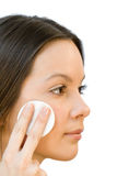 Young woman applying face cotton pads Royalty Free Stock Photos