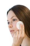 Young woman applying face cotton pads Stock Photos
