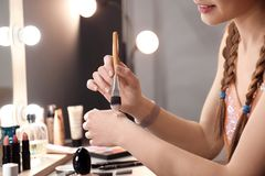 Free Young Woman Applying Foundation On Her Hand Stock Photos - 114250723