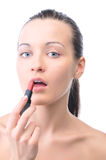 Young woman is applying lipstick Stock Photos