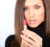 Young woman applying lipstick Royalty Free Stock Image