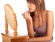 Young woman applying lipstick Stock Photography