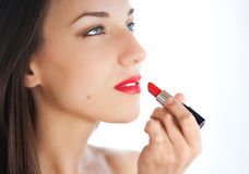 Young woman applying lipstick Royalty Free Stock Photography