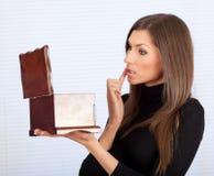 Young woman applying lipstick Stock Photo
