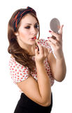 Young woman applying lipstick Stock Image