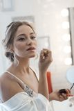 Young woman applying lipstick Royalty Free Stock Photo