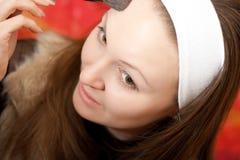 Young woman applying make-up Royalty Free Stock Image